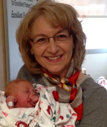 Cladach's publisher, Catherine, with newborn grandchild.