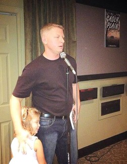 J. Dew with his daughter at an author event
